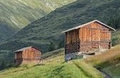 Swiss haylofts on the alpine meadows — Stock Photo