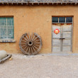 Old village with farm tools — Stock Photo