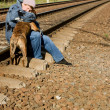A woman with a dog on the railroad — Stock Photo