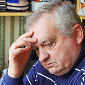 Portrait of sad elderly man — Stock Photo