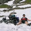 Stock Photo: Mresting after cycling ascent
