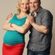 Foto Stock: Pregnant womwith her husband