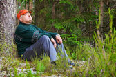Old man resting in a forest — Stock Photo