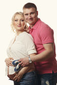 Happy young pregnant woman with her husband — Stock Photo
