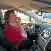 Middle-aged woman in a car — Stok fotoğraf