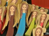 Woody, hand colored angels figures — Stock Photo