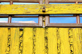Old window yellow wall closed woody shutter — Stock Photo