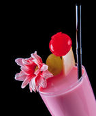 Alcohol pink drink, cocktail with flower, straw, isolated black — Stock Photo