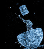 Ice cube blue water wave splash motion — Stock Photo