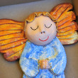 Little wooden painted angel figure sleeping in box — Stock Photo #21336073
