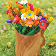 Bouquet multicolored artificial flowers in a vase — Stock Photo #21336997