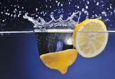 Lemon thrown into the water, motion, background — Stock Photo