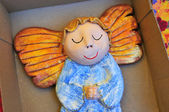 Little wooden painted angel figure sleeping in box — Stock Photo