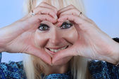 Woman making heart shape with her hands — Stock Photo