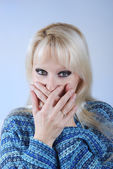 Woman hiding her mouth with her hands — Stock Photo