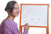 Young girl drawing on the white board — Stock Photo