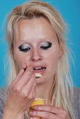 Young woman eatin cream — Stock Photo