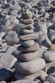 Pebble sculpture on a beach — Stock Photo