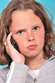 Portrait of teenager phoning — Stock Photo