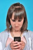 Girl with a mobile phone — Stock Photo