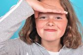 Girl shielding eyes — Stock Photo
