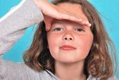 Girl shielding eyes — Stock Photo