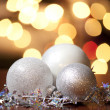 Christmas Balls against christmas lights — Stock Photo