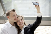 Couple taking self portrait with mobile phone — Stock Photo