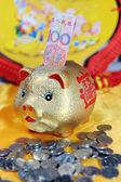 Mammon and aureate pig — Stock Photo