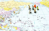 Business Tourism team in the world map — Stock Photo