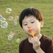 Young boy with bubbles — Stockfoto #2589429