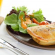 Chicken pie with salad and a glass of orange juice — Stok fotoğraf
