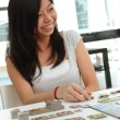 Stock Photo: Girl playing board game