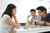 Friends playing a board game — Stock Photo
