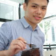 Asian man with his chocolate cake — Foto de Stock