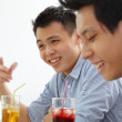 Two Asian men chatting over drinks — Stock Photo #30906007