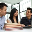 Asian college students studying in a cafe — Stock Photo