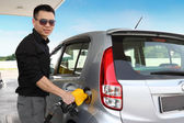 Man pumping gas — Stock Photo