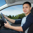 Stock Photo: Young mdriving