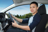 Young man driving — Stock Photo