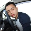 Tired young man asleep at the wheel — Stock Photo #42701227