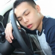 Tired young man asleep at the wheel — Stock Photo #42701229