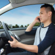Talking on mobile phone while driving — Stock Photo #45431113