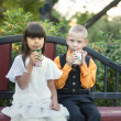 Boy and girl together in summer park - ストック写真