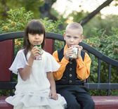 Boy and girl together in summer park — Stock Photo