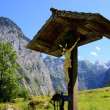 Wayside cross in the bavarian alps — Stock Photo