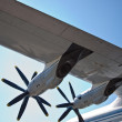 Detail view of a AN-22 wing and turboprop motors - Stock Photo