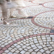 Moving Feet on paved Street with motion blur — ストック写真