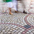 Moving Feet on paved Street with motion blur — Stock Photo