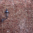 Part of the old city wall with lantern in Ladenburg, Germany - Stock Photo